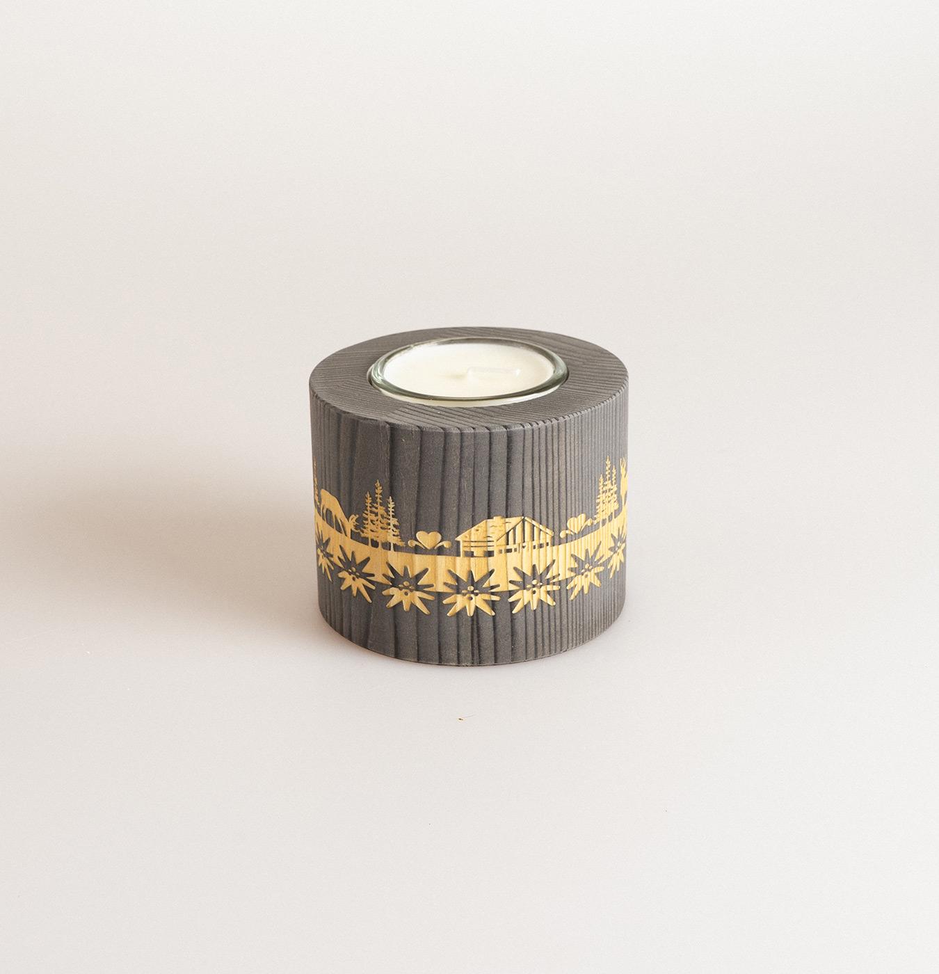 Portacandela tondo in legno di abete con candelina.